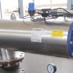 Filtaworx self cleaning filter installed atop large pipes and valves and guages